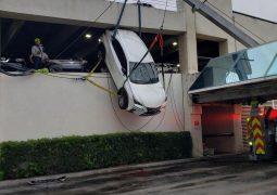 6336f130 lexus dangles over parking garage 6
